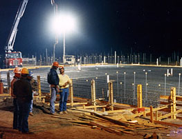 A meter-thick concrete floor is poured for the Continuous (DC) Field Facility.