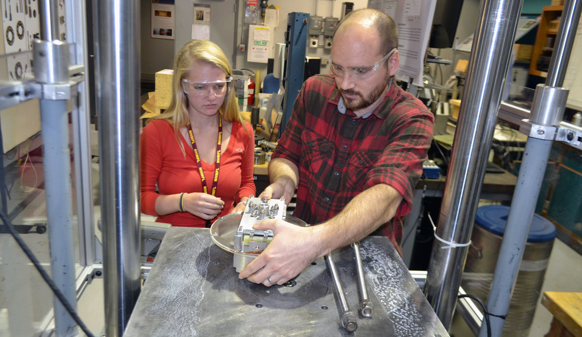 High school senior Rachael Steverson with mentor Adam Voran in the materials testing lab