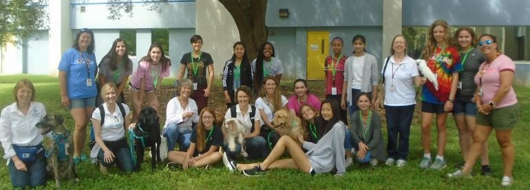SciGirls 2 and members of the TMH Animal Therapy staff