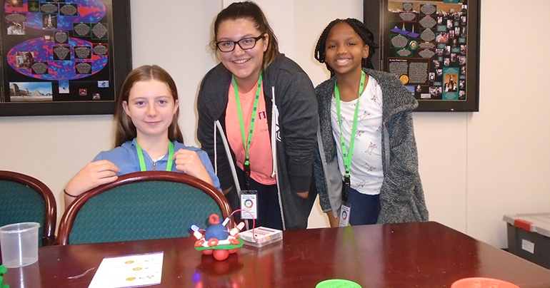 SciGirls campers make circuits with Playdoh.