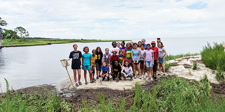 SciGirls Quest starting on a marsh walk at the FSU Coastal and Marine Laboratory.
