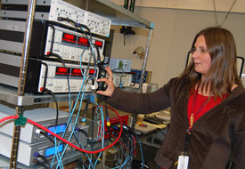 University of Pittsburgh scientist Daniela Bogorin adjusts an experiment on the fractional quantum hall effect in the Millikelvin Facility.