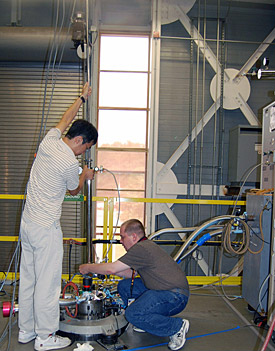 MagLab staffer Eun Sang Choi (left) assists West Virginia University scientist James Rall with an experiment in the Millikelvin Facility.