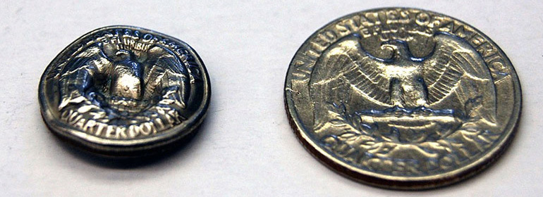 A shrunken quarter (left) next to a full-size quarter.