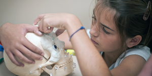 A SciGirls camper during a forensic anthropology session.