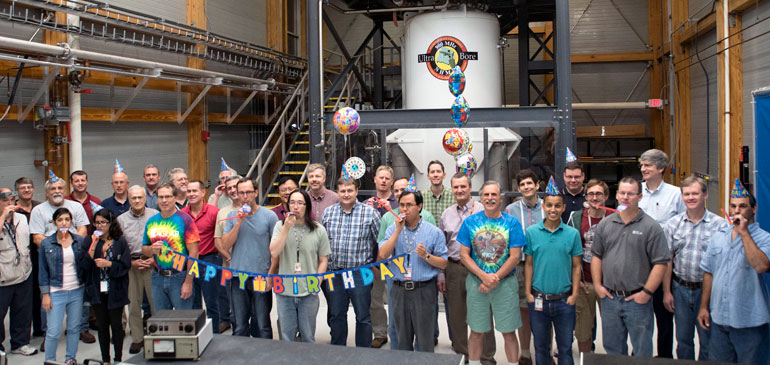 MagLab scientists, engineers and other staff celebrate the 10th anniversary of the commissioning of the  900 MHz nuclear magnetic resonance magnet.