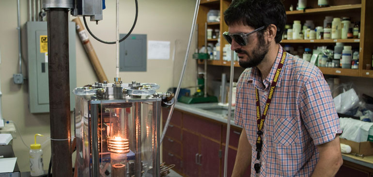 Physicist Ryan Baumbach monitors a crystal growth.