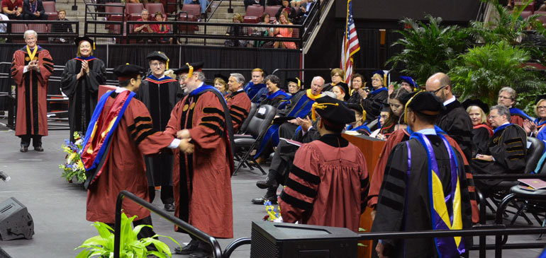 Peng Chen and his advisor, David Larbalestier, at Chen's hooding ceremony at Florida State University.