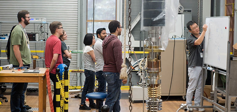 Summer school students learn how to use the MagLab's Millikelvin Facility