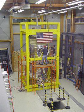 Workers install insulation around the 900 MHz magnet.