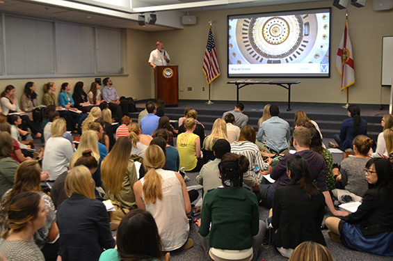 MagLab Director Greg Boebinger gives interior design students a primer about the lab.