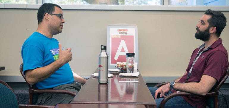 Staffers from opposite ends of the building (Jonathan Billings, left, and Steve Rowland) meet at SnackChat.
