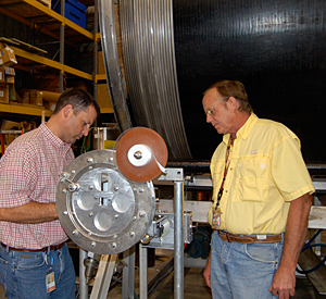 Lee Marks and Scott Bole with the machine they invented.