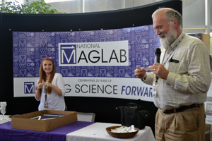 Public Affairs Director Kristin Roberts and MagLab Director Greg Boebinger unveil the new mark to staff.