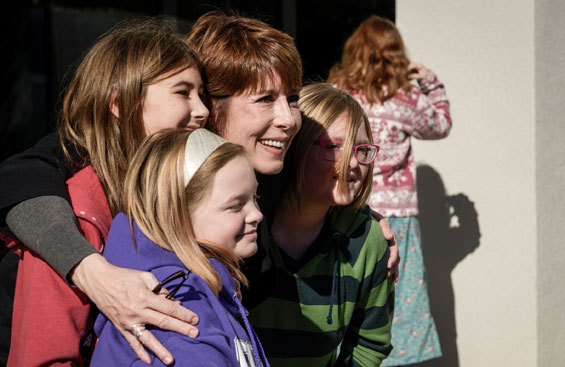 Gwen Graham poses for a photo with open house visitors.