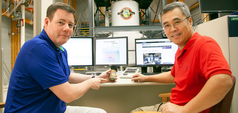 Samuel Grant (left) and Teng Ma at the MagLab's 900 MHz NMR magnet, which they will use for their stroke research.