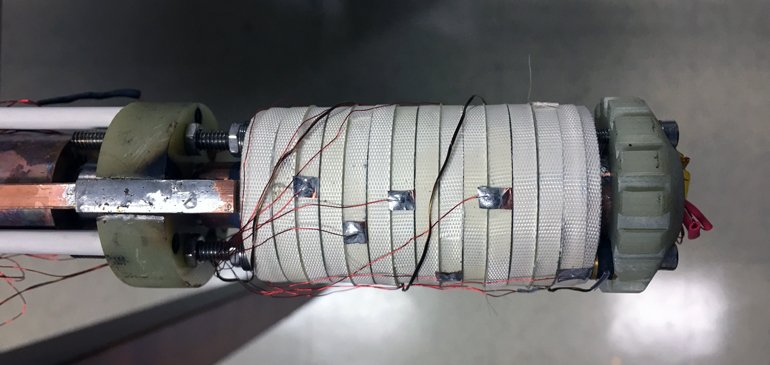 This little coil, about the size of an empty toilet tissue roll, helped scientists achieve a new world record for a continuous magnetic field, 45.5 teslas. The coil was wound using a superconductor called rare earth barium copper oxide (REBCO), then wrapped with white fiberglass tape.