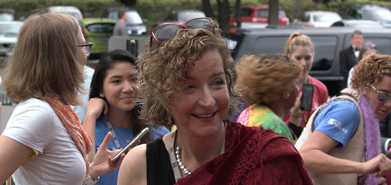 Laura Greene walks the red carpet as a science celebrity and waves to a crowd of adoring fans at the MagLab's movie-themed Open House in 2017.