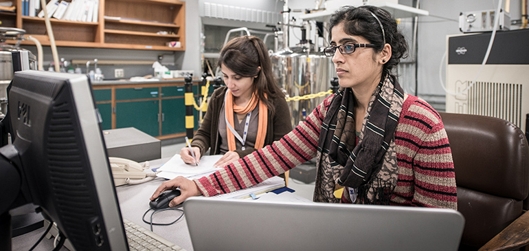 Two MagLab researchers work in the Electron Magnetic Resonance Facility.