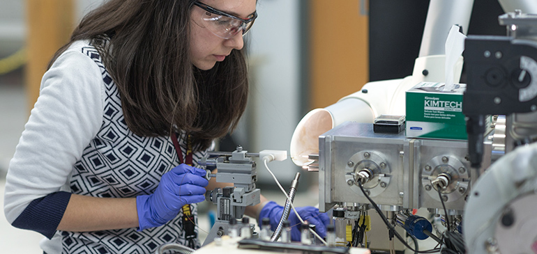 MagLab chemist performs experiment in Ion Cyclotron Resonance Facility.
