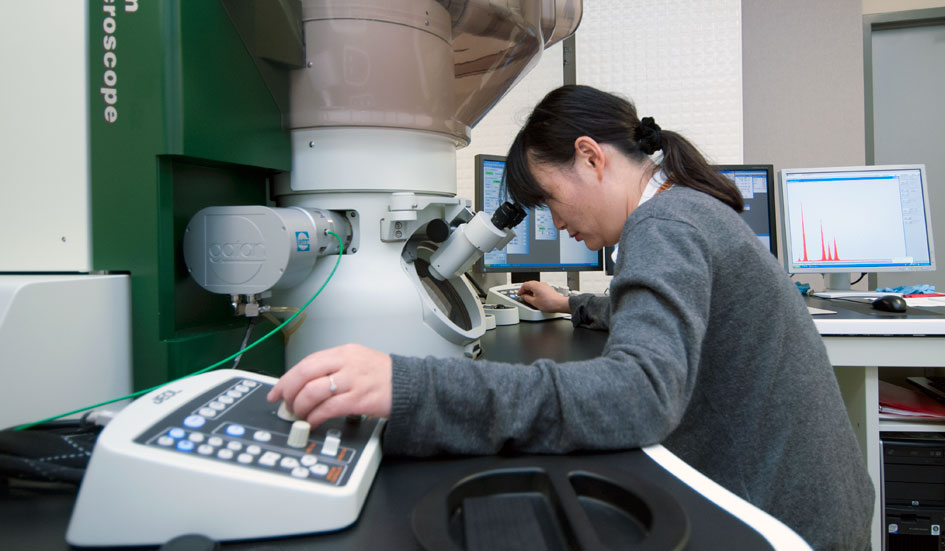 Scientist Yan Xin using the Transmission Electron Microscope.