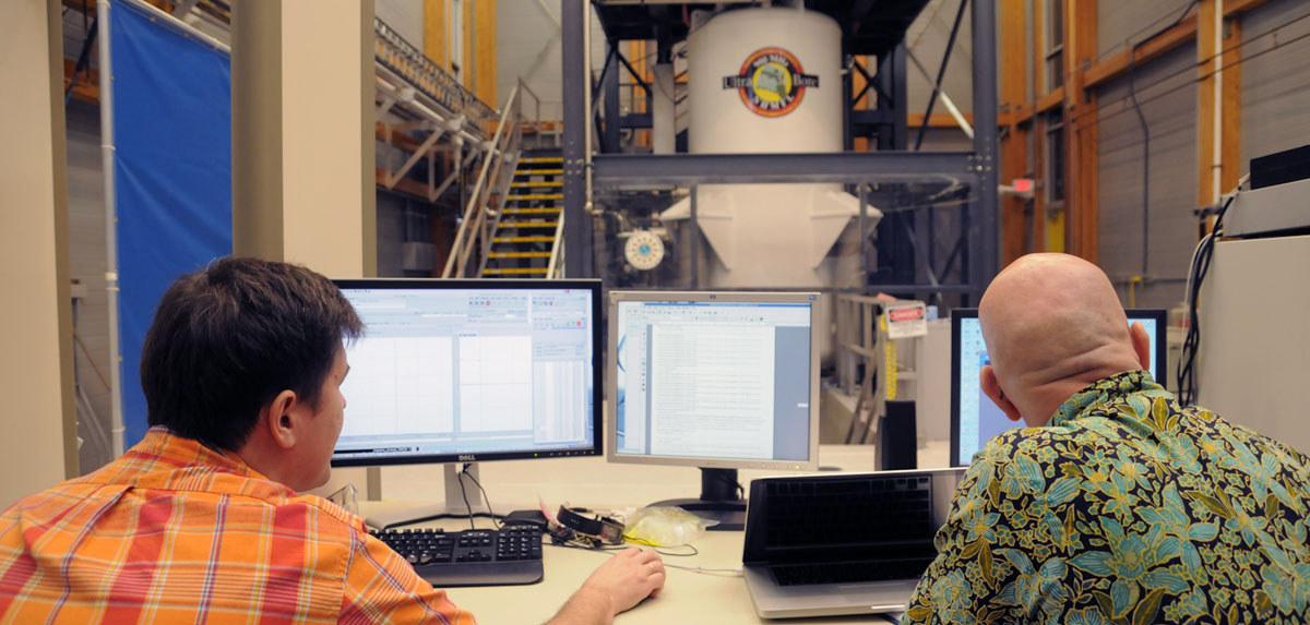 Scientists using the 900 MHz 105 mm NMR magnet.
