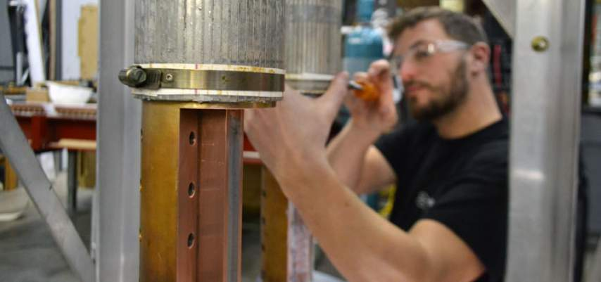 Research engineer Justin Deterding works on the current leads for the 36 tesla series connected hybrid magnet.