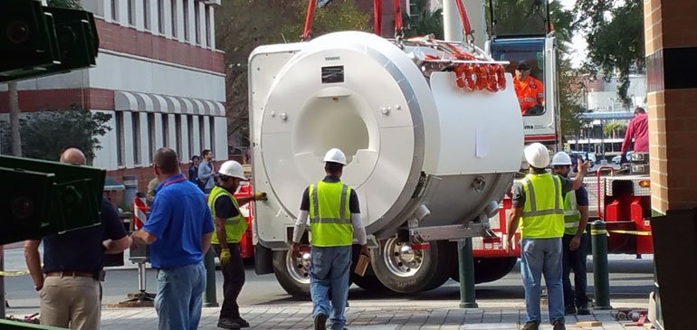 The new 3-T MRI machine heads into its new home at the MagLab.