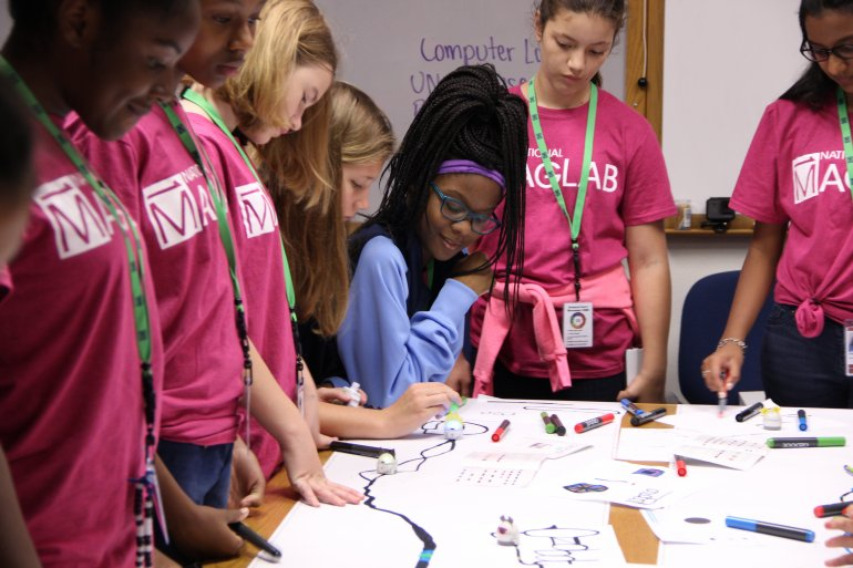 Campers learn coding using the programmable robots called Ozobots.