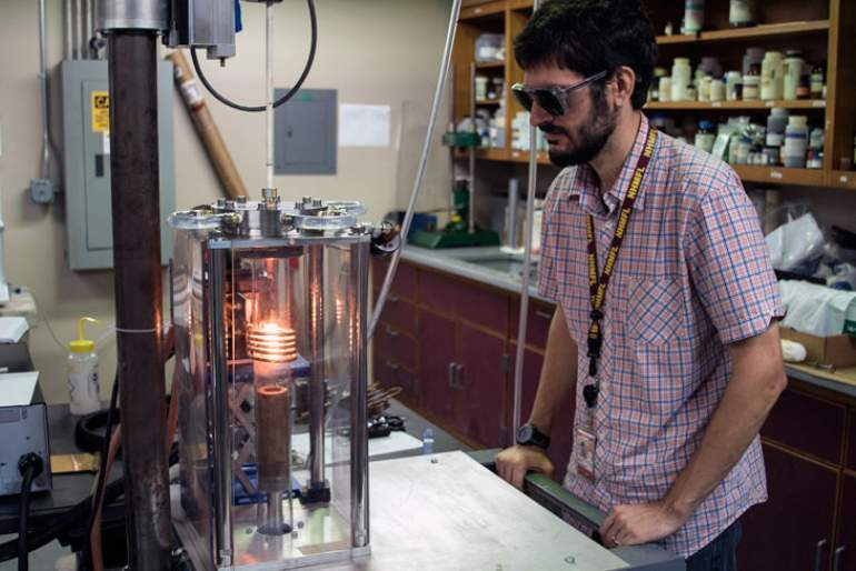 Ryan Baumbach monitors a crystal growth.