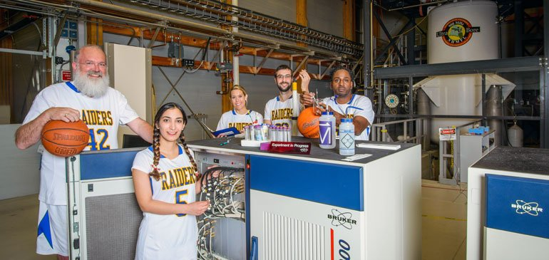 Team captain of the MagLab, Director Greg Boebinger (far left) with fellow team members from across the lab in front of the world-record 900 MHz NMR magnet.