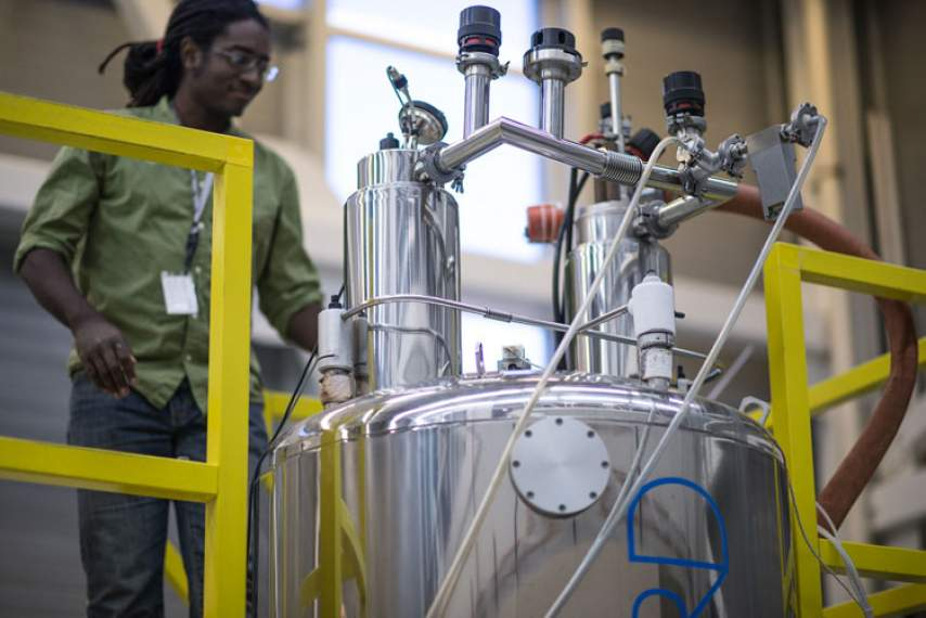 Scientists Jerris Hooker at work at the 720 MHz 52 mm NMR spectrometer.