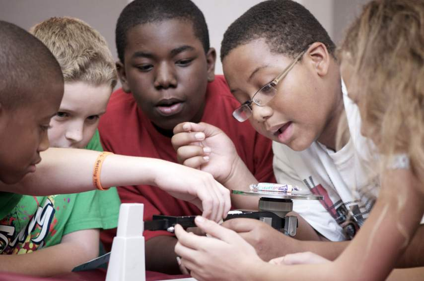 Students do a science activity at the MagLab.