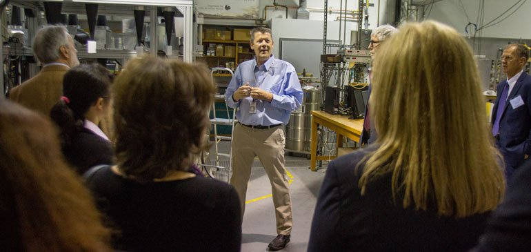 MagLab physicist Steve Hill gives a tour to participants of the 11th Meeting of the Group of Senior Officials for Global Infrastructures.