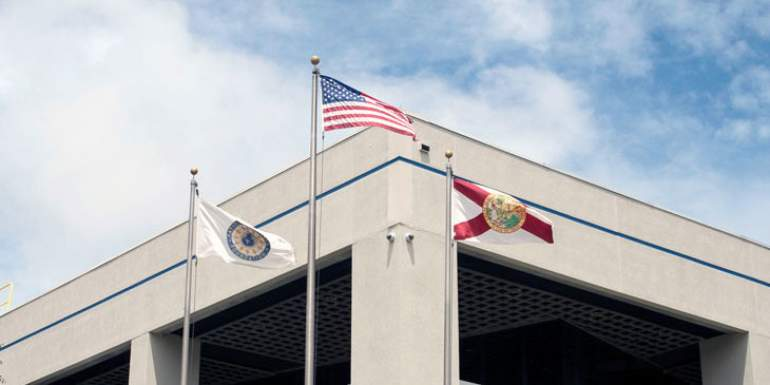 Flags wave in front of MagLab headquarters.