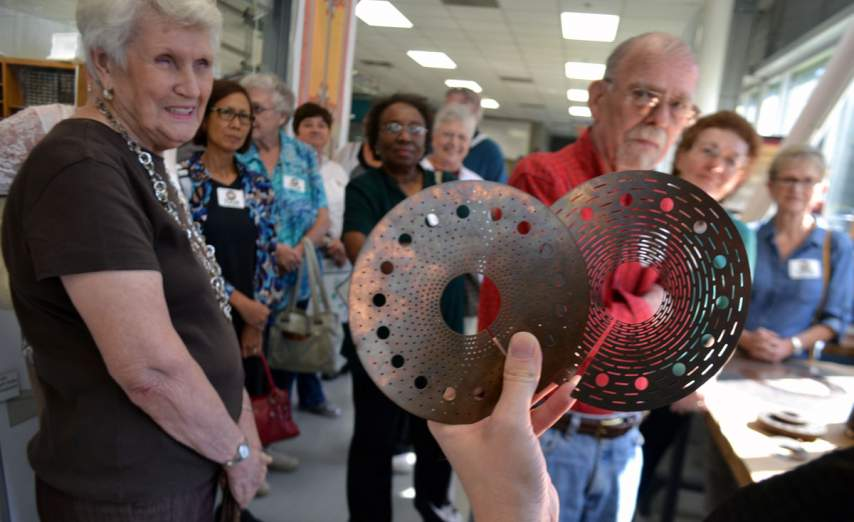 Visitors learn about how resistive magnets are made at the MagLab.
