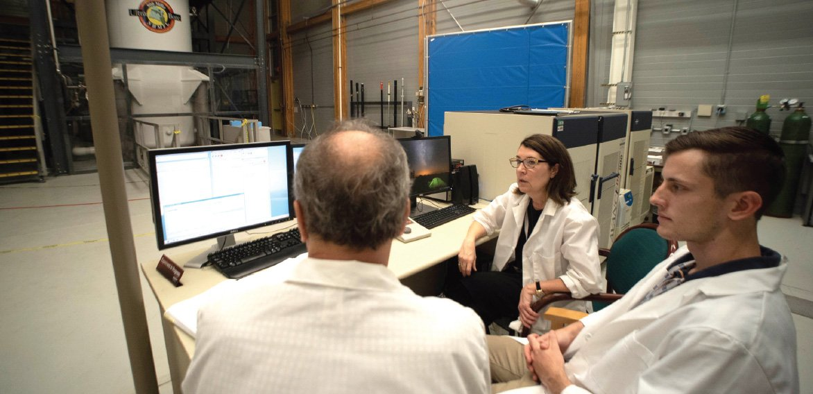 Cathy Levenson runs experiments with National MagLab physicist Victor Schepkin (left) and Florida State University undergraduate Nicholas Kynast on the MagLab's 21.1-tesla MRI magnet.