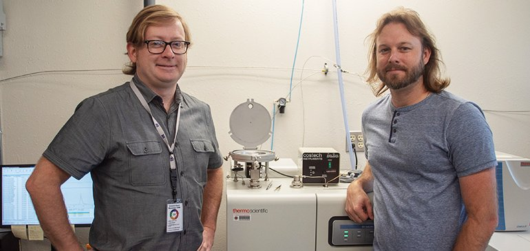 Geochemists Seth Young (left) and Jeremy Owens with the MagLab's Thermo elemental analyzer and isotope ratio mass spectrometer, which measured sulfur isotopes in their samples. Their data made clear the connections between historic changes in ocean oxygen levels and mass extinction of marine organisms.