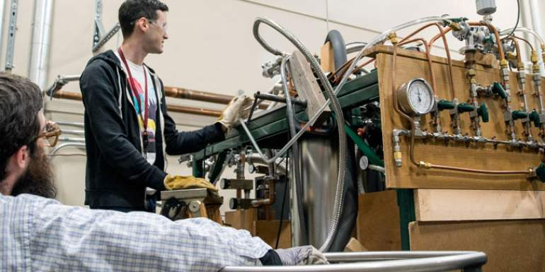 Engineers work to revive the magnetic levitation apparatus.