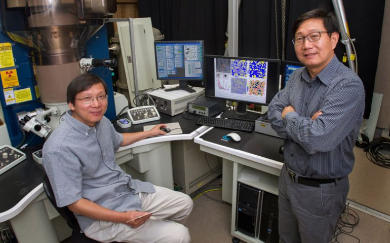 Brookhaven physicist Qiang Li (right) and materials scientist Lijun Wu.