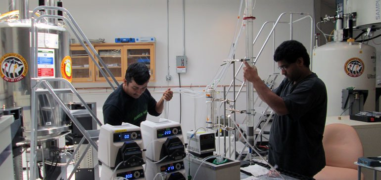 Researchers Ram Khattri (left) and Mukundan Ragavan work with the new cryoprobe.