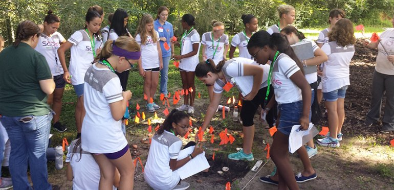 SciGirls campers search for clues on an archeological dig.