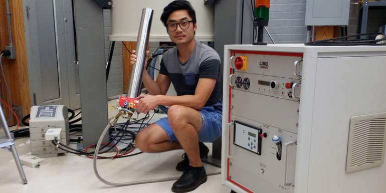 Graduate research assistant Po-Hsiu Chien with the new high-temperature laser probe.