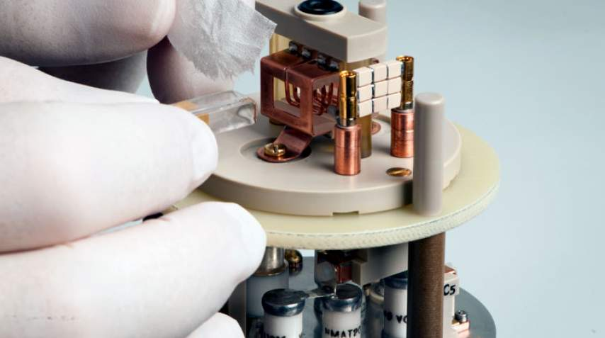 Inserting a sample into the low-E probe.