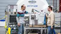 MagLab scientists Nate Kaiser (left) and Donald Smith with the 21 tesla magnet and its instrumentation.