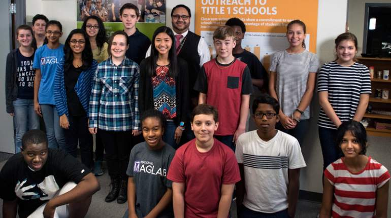 Students enrolled in the 2015 Middle School Mentorship program, pictured with program coordinator Carlos Villa (wearing tie).