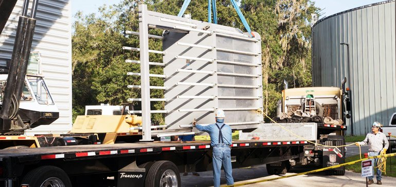 Workers offload the MagLab's new 35,000-pound heat exchanger.